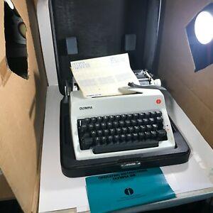 Vintage OLMPIA SM9 Portable Typewriter with Case White