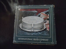 INTERNATIONAL SILVER CO. SILVERPLATED EMBOSSED COASTERS-6 COASTERS + HOLDER-1991