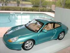 NIB ~ UT MODELS 27901 PORSCHE CARRERA 996 COUPE METTALIC GREEN 1/18 DIE-CAST CAR