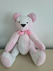 Handmade girls teddy bear with moveable arms and legs with goddaughter charm.