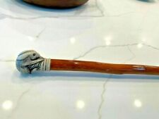 Vintage Cane Simulated Scrimshaw Rabbit Handle Resin mounted on a Burled wooden