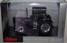 Tracteurs miniatures noirs Schüco