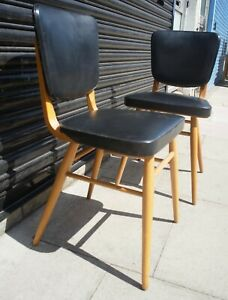 Two vintage 1950s Beech and vinyl side/dining chairs