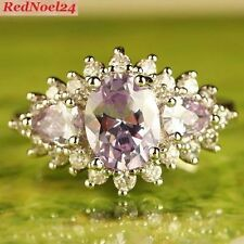 Graduation Solitaire with Accents Amethyst Fine Rings