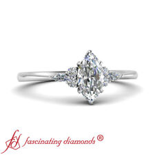 Platinum Tapered Engagement Ring With 0.75 Carat Marquise Cut And Round Diamond