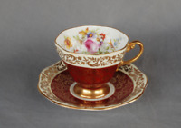 One Foley china tea cup and saucer. Burgandy with flowers and gold accents.