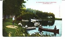 ST. CHARLES BOAT LANDING IN WOOD RIVER, SYLVAN BEACH, N.Y. MAN FISHING ON BANK.