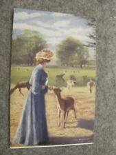 Tuck's Country Life series postcard - Glamerous Lady feeding Deer