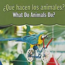 Que Hacen Los Animales? / What Do Animals Do? (Spanish Edition)-ExLibrary