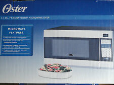 Oster Ogzb1101 Countertop Microwave Oven - 1000 Watts - 1.1 cu ft