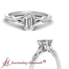 Half Carat Emerald Cut Diamond Solitaire Cathedral Engagement Ring In Platinum
