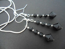 A SILVER PLATED BLACK CRYSTAL NECKLACE AND  EARRING SET. NEW.