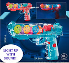 LIGHT UP MECHANICAL GEAR MOVING TOY GUN WITH MUSIC. TY481 pistol transparent new
