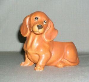 Vintage Dachhund Ceramic Figurine Planter Vase is in great condition
