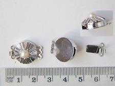 Konvolut (Lot), 4  dreireihige Schließen mit Perle, rhodiniert