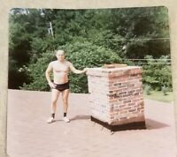 "Vintage Snapshot 4 x 4""  Photograph 1980s Man on roof in short shorts gay int"