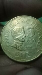 2012 5peso Face Error Coin.error on the reverse and overse.