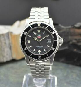 Tag Heuer WD1210-D0 Professional Steel Black Date Dial Quartz Watch