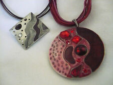 Lot of 2 pendant necklaces abstract designs 1-grey & black - 1 - red with RS