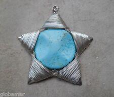 Colgante estrella de metal plateado y piedra turquesa