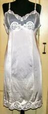 Vintage white/off white size 36 petite full slip with a semi sheer lacy bodice