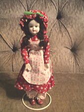 UCGC TWIWAN PORCELAIN DOLL DRESSED IN RED WITH BONNET