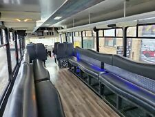 2002 Party bus Freightliner shuttle bus with wrap around and fw seating