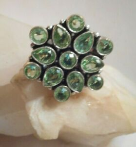 Silver ring with 13 pale green Peridot stones 7 round and 6 water drop shaped