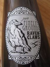 Finely Ground Raven Claws Label on a Corked and Sealed SmokeColored Empty Bottle