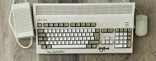 Amiga 1200 with hard drive (CF card), Accelerator, games, mouse and p-supply