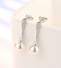 Super sweet silver tone hanging white pearl earrings with crystal