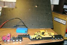 Ho Scale tractor with lowboy loaded trailer and working lights