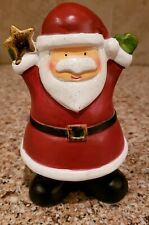 Holiday Home Santa Holding gold star hands up in air 6 1/2 tall.