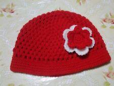 berretto in lana bimba color rosso con fiore