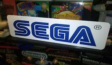 "Sega Display, Aluminum Sign, 6"" x 24""."