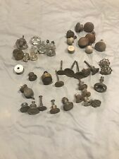 Assortment of antique glass, brass, and wooden knobs