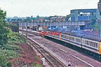 PHOTO  DMU PASSING  NEWBURY EAST SIGNAL BOX 1977