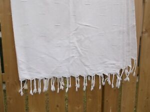 HEAVY  OFF WHITE WITH BLUE TINT EMBOSSED  FRINGED BOTH END.THROW.