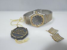 VINTAGE WOMAN'S EBEL 18K GOLD AND STAINLESS STEEL WATCH WITH DIAMOND BEZEL