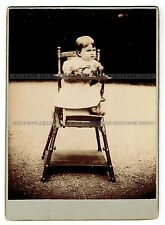 Big Cabinet Photo Child with toys sitting in a high chair (1703)