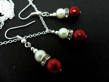 A DARK RED/IVORY GLASS PEARL  NECKLACE AND EARRING SET. NEW.