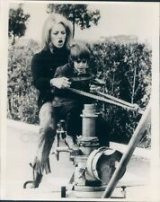 1969 Press Photo Actress Nathalie Delon & Son Play With Movie Camera Stand