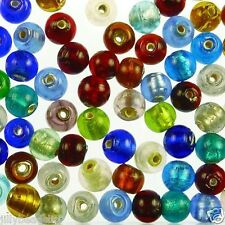 Indian glass foil lined round beads. Sold in 25g packs containing approx 50 bead