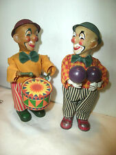 2 VINTAGE WIND UP LITHO, CLOTH, PLASTIC CLOWNS, TIN DRUM, MARACAS, HATS ,BOWTIES