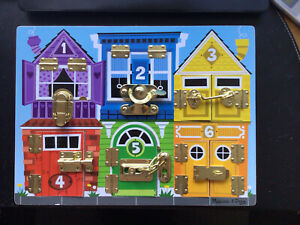 Melissa and Doug Wooden  Locks and Latches Board.