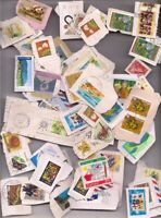 68 AUSTRALIA stamps on paper.