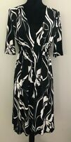 Tokito Women's size 10 Black and White Floral Stretch Fabric Short Sleeve Dress