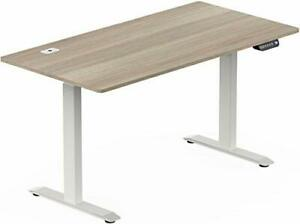 SHW 55-Inch Large Electric Height Adjustable Standing Desk, 55 x 28 Inches, Oak
