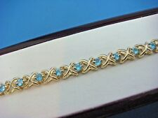 GORGEOUS 14K YELLOW GOLD AND 2.5 CT T.W. BLUE ZIRCON TENNIS BRACELET, 15.1 GRAMS
