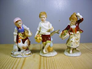 Three Small Pottery or Porcelain Child Agrarian Figures